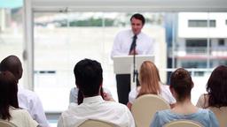 Man in suit speaking in a meeting Footage