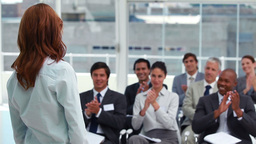 Audience applauding a businesswoman Footage