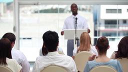Confident businessman giving a speech Footage