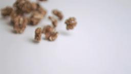 Walnut kernels falling in super slow motion Footage