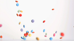 Colored candies falling in super slow motion Footage