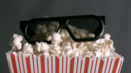Popcorn box falling in super slow motion with 3D g Footage