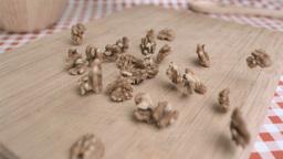 Walnut kernels being spread in super slow motion Footage