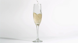 Champagne being poured in super slow motion in a f Footage