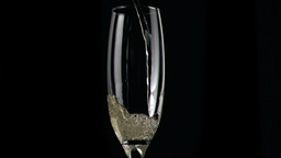 Champagne being poured in super slow motion in gla Footage