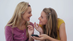 Two friends laughing after a phone call Footage
