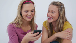 Laughing friends text messaging Footage