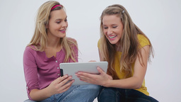 Women sitting while using an ebook Footage