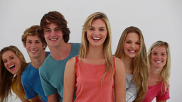 Young People Appearing Behind Their Friends stock footage