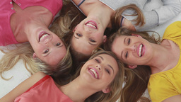 Happy young women lying together Footage