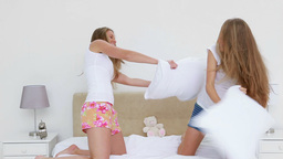 Joyful women having a pillow fight Footage