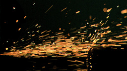 Sparks flowing in super slow motion on a surface Footage