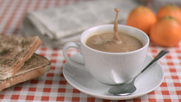 Coffee with milk in super slow motion receiving su Footage