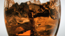 Ice cubes in super slow motion falling in a glass Footage