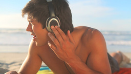 Man listening to music with headphones Footage