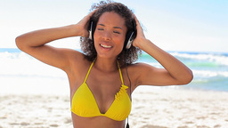 Woman listening music with headphones Footage