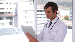 Doctor using a touchscreen tablet Footage