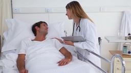 Doctor reassuring her patient Footage