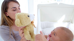 Baby girl kissing her teddy bear Footage
