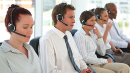 Group of business men and women on headsets Footage