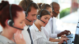 A large business team wearing headsets Footage