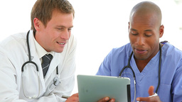 Two medical professionals using a tablet pc Footage