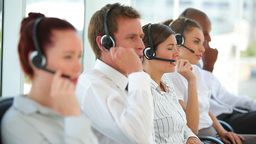 Business workers talking on headsets Footage