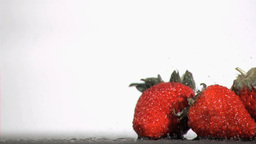 Raindrops falling in super slow motion on fruits Footage