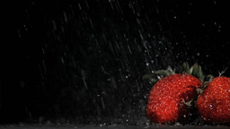 Drops falling in super slow motion on strawberries Footage