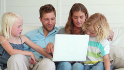 Family watching something on a laptop together Footage