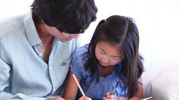 Father helping his daughter with her homework Live Action