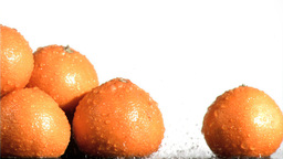 Water falling in super slow motion on oranges Footage