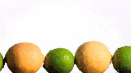Lemons and limes in super slow motion being wet Footage