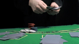 Hands in super slow motion dealing the cards Footage