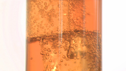 Melting ice in super slow motion in apple juice Footage