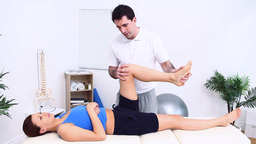 Physiotherapist massaging the knee of a patient Footage