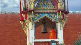 Thai Monk Hit Big Bell In Temple Wide stock footage