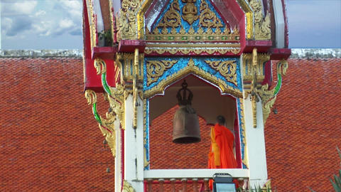 thai monk hit big bell in temple wide Footage