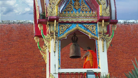 thai monk hit big bell in temple wide Stock Video Footage