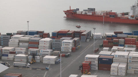 time lapse of container ship leaving container terminal Stock Video Footage