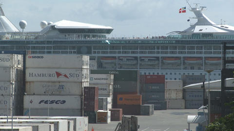 cruise ship behind containers plus truck Stock Video Footage