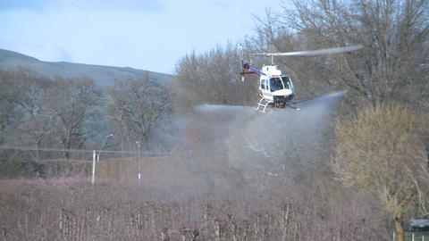 front on helicopter spraying Stock Video Footage