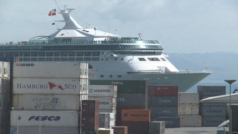 cruise ship passes behind containers Stock Video Footage