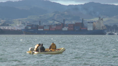 inflatable craft and container ship Stock Video Footage