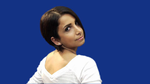 Young woman posing for camera, blue screen backgro Footage