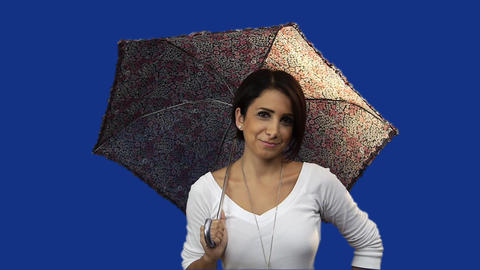 Young woman holding umbrella, blue screen background Footage
