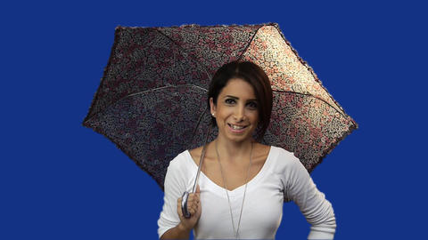 Young woman holding umbrella, blue screen background Stock Video Footage