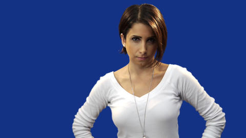 Young woman posing for camera, blue screen background Stock Video Footage