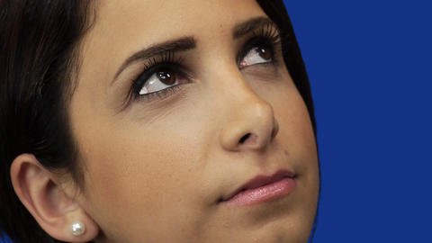 Young woman gazing up at sky, blue screen background Stock Video Footage