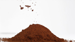 Slow motion of brown powder falling Stock Video Footage